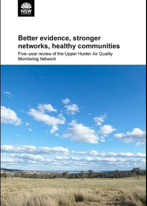 Cover of five-year review with image of grasslands in foreground and trees in background under a blue sky