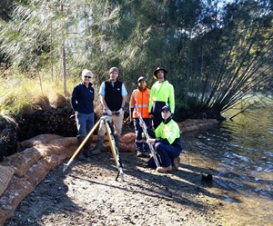 Greater Sydney Local Land Services / Oceanwatch Australia team next to a riverbank