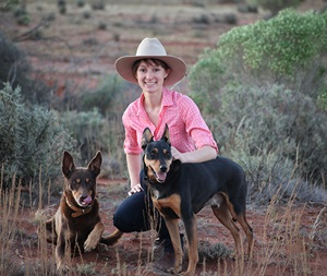 Anika Molesworth with 2 kelpies, one red and one black and tan