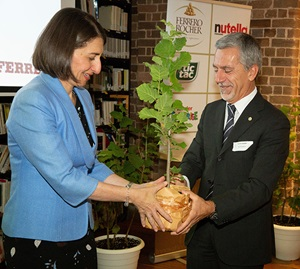 Representative from Ferrero Australia receiving tree from Premier Gladys Berejiklian