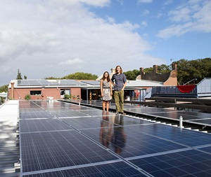 Stucco members on a rooftop amongst solar panels