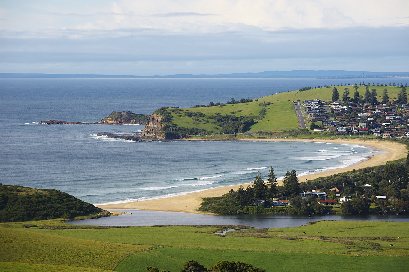 View over paddocks to the estuary and coast at Gerringong NSW