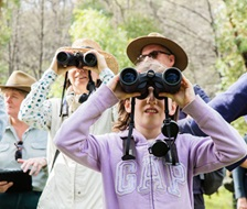 Group of people birdwatching