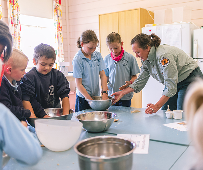 Students at Adaminaby Public School baking Bogong biccies