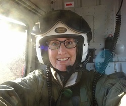 Dr Sarah Bell in a helicoptor