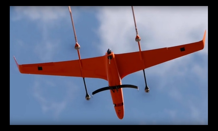 Orange drone in flight