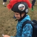 Boy wearing bike helmet with red 'plumage' and bird image, Bird Week celebrations