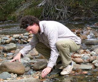 Dr David Hunter checking frog habitat