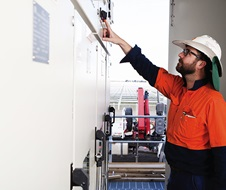 A worker during set up at Moree Solar Farm. Moree, NSW.