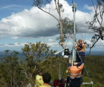 New fire detection camera being installed on a ridge overlooking the Clarence Valley
