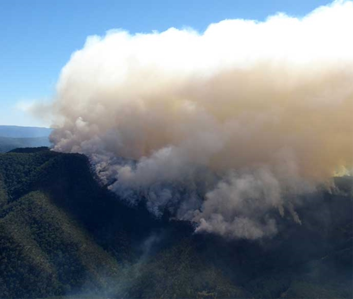Aerial Incendiary hazard reduction smoke plume Kittys Creek in Guy Fawkes National Park