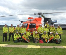 North Coast rapid response team in front of helicopter