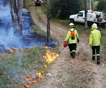 Park ranger and trainee field officer conducting hazard reduction burn