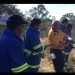 Rural fire service instructs group with fire hose