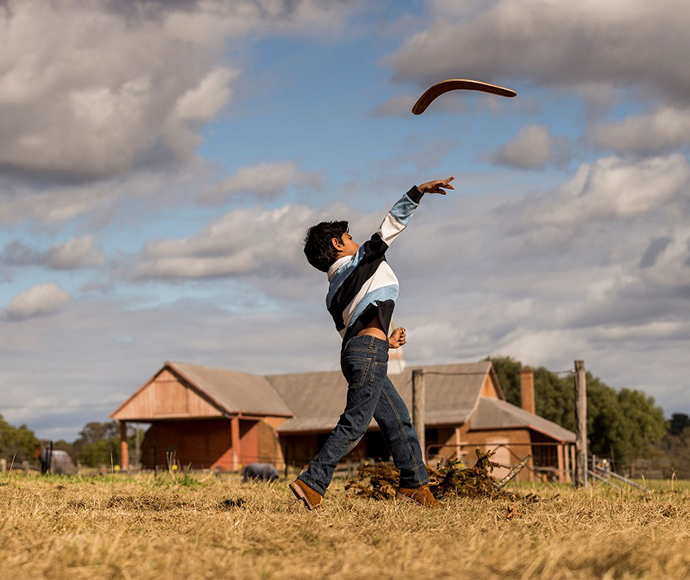 Boy throwing a boomerang, Rouse Hill House and Farm