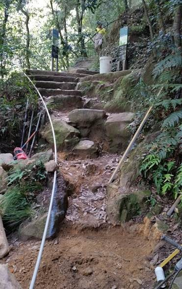 Damaged and incomplete stone stairs on walking track in Blue Mountains National Park