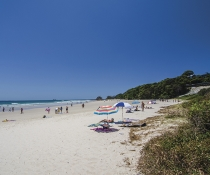 People enjoying a beach in Cape Byron State Conservation Area