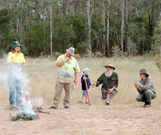 Edmondson Regional Park opening - 8 October 2017 Daniel Chalker, Lex Dadd, Lester Ives join NPWS Ranger Toni Clarke at a smoking ceremony as part of the welcome at the opening of the Cabramatta Creek precinct at Edmondson Regional Park, 8 October 2017