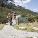 Mountain bikers enjoying a day of riding on the Thredbo Valley Track, Kosciuszko National Park.