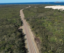 An aerial image of the new stretch of Mungo Brush Road, with the former part of Mungo Brush Road just visible on the right-hand side. The old road has now been rehabilitated.