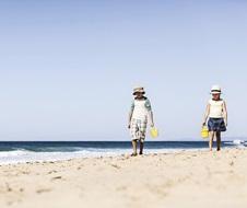 Children walking along Garie Beach, Royal National Park