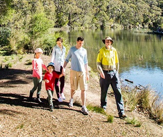 Park ranger and family explore Hacking River, Royal National Park