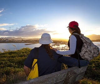 Couple on Solitary Islands Coastal Walk and looking over Coffs Harbour