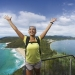 Woman reaching Tomaree Head Summit, Mount Tomaree, Port Stephens.