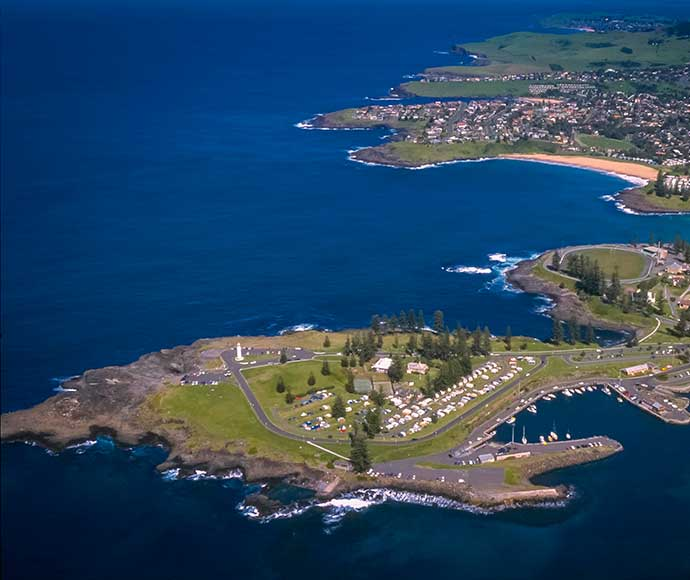 Aerial view, Kiama Harbour Light is an active lighthouse at Blowhole Point, south of Kiama Harbour