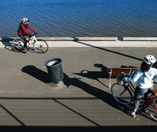 Cyclists ride along the waterside of Parramatta River. Rhodes, Sydney, NSW.