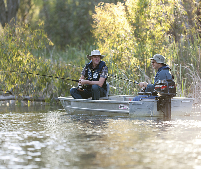 Two men fishing from a small boat, Gulpa Creek, Murray Valley National Park